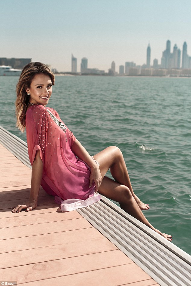 The mother-of-two, CEO and beauty ambassador looks radiant in an embellished kaftan as she shows off her flawless skin from the shores of Dubai