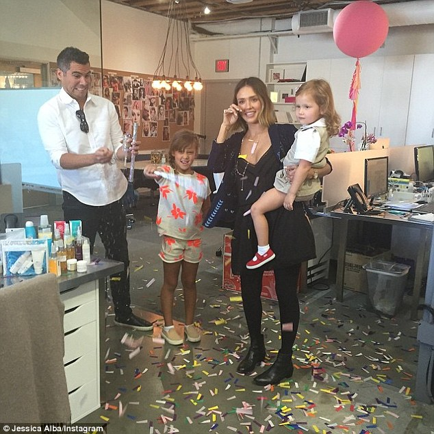 The mother-of-two shared an Instagram snap of her her husband Cash Warren and their two little girls showering her with gifts and confetti