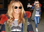 24 Oct 2015 - LONDON - UK *** EXCLUSIVE ALL ROUND PICTURES *** AUSSIE MODEL ELLE MACPHERSON SEEMS IN GREAT SPIRITS AS SHE FLIES INTO HEATHROW AIRPORT AFTER ATTENDING A LUXEPACK EVENT IN NICE! BYLINE MUST READ : XPOSUREPHOTOS.COM ***UK CLIENTS - PICTURES CONTAINING CHILDREN PLEASE PIXELATE FACE PRIOR TO PUBLICATION *** **UK CLIENTS MUST CALL PRIOR TO TV OR ONLINE USAGE PLEASE TELEPHONE 44 208 344 2007**