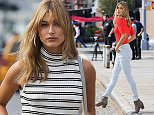 EXCLUSIVE: Hailey Baldwin seen at a photo shoot for EXPRESS clothing company in New York.  Pictured: Hailey Baldwin Ref: SPL1159832  231015   EXCLUSIVE Picture by: TMNY / Splash News  Splash News and Pictures Los Angeles: 310-821-2666 New York: 212-619-2666 London: 870-934-2666 photodesk@splashnews.com