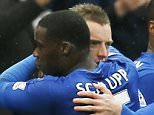 "Football - Leicester City v Crystal Palace - Barclays Premier League - King Power Stadium - 24/10/15  Leicester City's Jamie Vardy celebrates scoring their first goal with Jeffrey Schlupp and teammates  Action Images via Reuters / Andrew Boyers  Livepic  EDITORIAL USE ONLY. No use with unauthorized audio, video, data, fixture lists, club/league logos or ""live"" services. Online in-match use limited to 45 images, no video emulation. No use in betting, games or single club/league/player publications.  Please contact your account representative for further details."