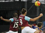 West Ham United's English striker Andy Carroll (2nd L) scores his team's second goal during the English Premier League football match between West Ham United and Chelsea at The Boleyn Ground in Upton Park, east London on October 24, 2015. AFP PHOTO / IAN KINGTON RESTRICTED TO EDITORIAL USE. No use with unauthorized audio, video, data, fixture lists, club/league logos or 'live' services. Online in-match use limited to 75 images, no video emulation. No use in betting, games or single club/league/player publications.IAN KINGTON/AFP/Getty Images