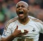 BRIMINGHAM, ENGLAND - OCTOBER 24:  Andre Ayew of Swansea City celebrates after scoring a goal to make it 1-2 during the Barclays Premier League match between Aston Villa and Swansea City at Villa Park on October 24, 2015 in Birmingham, England.  (Photo by Matthew Ashton - AMA/Getty Images)