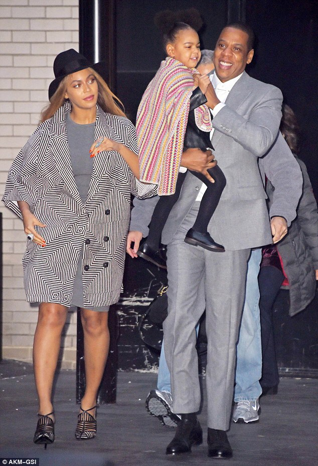 One big happy family! Beyonce, 33, and Jay Z, 45, pictured with three-year-old daughter Blue Ivy in NY last December
