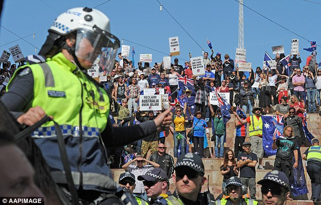 More than 3,000 people clashed in Melbourne's Federation Square (pictured) and blocked surrounding streets