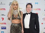 MELBOURNE, AUSTRALIA - SEPTEMBER 05:  Geoffrey Edelsten and Gabi Grecko arrive ahead of the Red Ball 2015 at the Grand Hyatt on September 5, 2015 in Melbourne, Australia.  (Photo by Kristian Dowling/Getty Images)