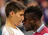 BRIMINGHAM, ENGLAND - OCTOBER 24:  Federico Fernandez of Swansea City and Micah Richards of Aston Villa square up to each other during the Barclays Premier League match between Aston Villa and Swansea City at Villa Park on October 24, 2015 in Birmingham, England.  (Photo by Matthew Ashton - AMA/Getty Images)