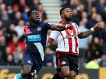 Sunderland's Jeremain Lens, right, vies for the ball with Newcastle United's Chieck Tiote, left during their English Premier League soccer match between Sunderland and Newcastle United at the Stadium of Light, Sunderland, England, Sunday, Oct. 25, 2015. (AP Photo/Scott Heppell)