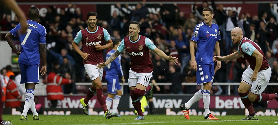 Zarate runs away in celebration after scoring against Chelsea as the Premier League champions got off to a bad start