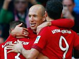 Bayern Munich's Arjen Robben (2nd R) celebrates with team mates after he scored against Cologne during their Bundesliga first division soccer match in Munich, Germany October 24, 2015.  REUTERS/Michael Dalder. DFL RULES TO LIMIT THE ONLINE USAGE DURING MATCH TIME TO 15 PICTURES PER GAME. IMAGE SEQUENCES TO SIMULATE VIDEO IS NOT ALLOWED AT ANY TIME. FOR FURTHER QUERIES PLEASE CONTACT DFL DIRECTLY AT + 49 69 650050