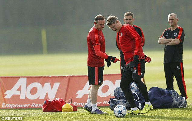 Wayne Rooney (left) and Bastian Schweinsteiger (right) take part in Man United training earlier this week