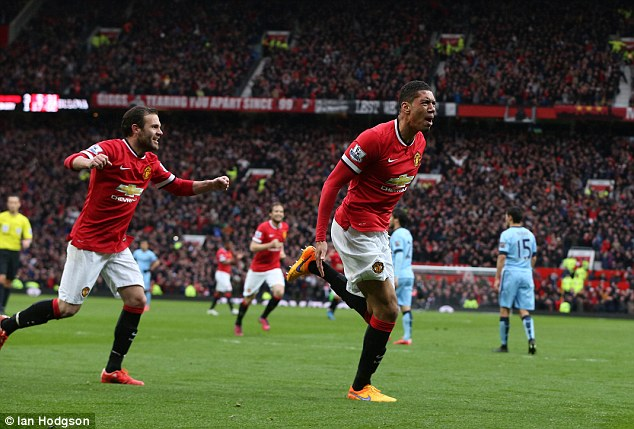 Chris Smalling wheels away in jubilation after scoring against City in the 4-2 derby win for United last season