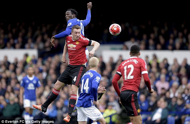 United centre back Phil Jones keeps his eye on the ball whilst heading a clearance at Goodison Park