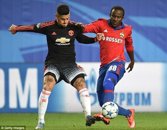 Marcos Rojo, putting in a tackle on CSKA Moscow'sSeydou Doumbia, will feature in the absence of Luke Shaw