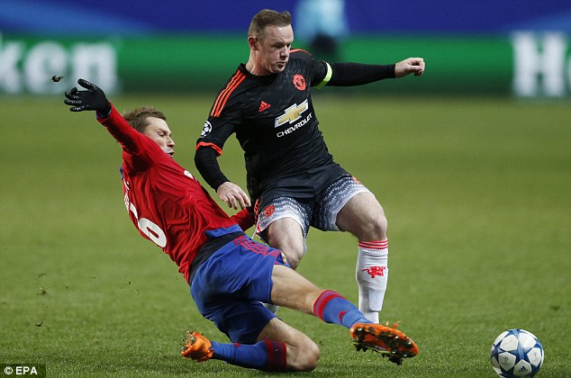 Manchester United captain Wayne Rooney, shielding a challenge, will hope to secure another derby victory
