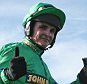 Liam Treadwell on Mon Mome celebrates after winning the John Smith's Grand National Steeple Chase Handicap on Mon Mome at Aintree on April 4, 2009 in Liverpool, England.    (Photo by Warren Little/Getty Images)