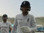 England's Joe Root leaves the field at stumps during the second Test Match between Pakistan and England played at the Dubai cricket stadium in Dubai on October 25th 2015