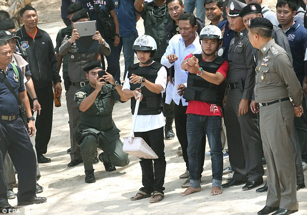 Burmese migrants Zaw Lin (left in helmet) and Win Zaw Htun (right in helmet), both 21, were arrested two weeks after their semi-naked bodies were found