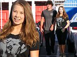 UK CLIENTS MUST CREDIT: AKM-GSI ONLY\nEXCLUSIVE: Bindi Irwin holds hands with boyfriend Chandler Powell as they exit with her mother Terri at the 'Dancing With The Stars' dance studio in Hollywood.