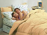 A stock photo of couple sleeping on a full-height airbed. A full-height airbed for £89.99.