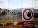 """A sign hanging on a fence reading """"prohibited access"""" is seen along ancient Roman cobbled street at the UNESCO World Heritage site of Pompeii, October 13, 2015. Years of neglect at the ancient Roman city of Pompeii are being dug and scrubbed away in a last-minute bid to keep money flowing from a huge European Union-backed renovation programme. Picture taken October 13, 2015. To match Feature ITALY-POMPEII/   REUTERS/Alessandro Bianchi"""