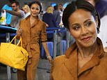 """Los Angeles, CA - """"Gotham"""" actress Jada Pinkett-Smith sports a stylish brown trench coat while accessorizing with a yellow Goyard bag at LAX.\nAKM-GSI          October 25, 2015\nTo License These Photos, Please Contact :\nSteve Ginsburg\n(310) 505-8447\n(323) 423-9397\nsteve@akmgsi.com\nsales@akmgsi.com\nor\nMaria Buda\n(917) 242-1505\nmbuda@akmgsi.com\nginsburgspalyinc@gmail.com"""