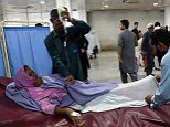 A Pakistani paramedic treats a woman injured in an earthquake at a hospital in Peshawar on October 26, 2015. At least 17 people including eight children were killed in Pakistan when a 7.5 magnitude quake struck in Afghanistan October 26, officials said. AFP PHOTO / A MAJEEDA Majeed/AFP/Getty Images