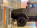 """A female visitor to a military exhibition tried to drive off in one of the army¿s armour plated trucks.\n\nThe unnamed woman smashed into as retaining wall breaking the glass panels and damaging the front of the vehicle.\n\nThe bizarre incident happened in one of the pavilions of the all-Russian exhibition centre that is located in Moscow, Russia.\n\n The exhibition """"Interpolitekh"""" is devoted to special vehicles that ensure country¿s  safety and security.\n\nStaff did not realise the keys of the vehicle were still in the ignition and the woman driver drove the vehicle off its stand but then stalled when she crashed.\n\nPictures show the glass door and panel she broke as the debris littered the floor.\n\nSome officials tried to cover the incident up saying the large vehicle had just rolled off its stand on its own accord.\n\n Exhibition  spokesman Irina Gerasimova said:"""" """"Unfortunately, one of the exhibits was moved and driven into the wall. There will be  an analysis of all the circum"""