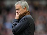 Chelsea manager Jose Mourinho looks dejected as Nemanja Matic of Chelsea is sent off during the Barclays Premier League match between West Ham United and Chelsea played at The Boleyn Ground, London on October 24th 2015