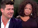 """13 October 2013 - Los Angeles - USA\n\n\n\n**** STRICTLY NOT AVAILABLE FOR USA ***\n\n\n\nRobin Thicke talks to Oprah Winfrey about 'Twerking' wiht Miley Cyrus, his marriage and his career. The Blurred Lines singer appeared on Oprah's Next Chapter to talk frankly about the recent controversy surrounding his MTV VMA performance with Cyrus. And Thicke took no time in putting the blame for the controversial performance on Miley. He claimed he was simply 'twerked upon,' and was too busy focusing on his singing to see what Miley was doing. He told Oprah: """"So to me, Iím walking out towards Miley, Iím not thinking sex, Iím thinking fun."""" Curious how that could even be possible, Oprah - who physically displayed her distaste for the situation - interrupted: """"But she was twerking up against your kahoonas."""" And Thicke replied: """"But you have to remember I'm singing my butt of, so I'm sitting there, I'm looking up at the sky, I'm singing. I'm not really paying attention to all that. That's on her."""