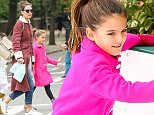 25 OCT 2015 - NEW YORK - USA *** STRICTLY AVAILABLE FOR UK AND GERMANY USE ONLY *** ***EXCLUSIVE ALL ROUND PICTURES AVAILABLE FOR UK NEWSPAPERS ONLY*** KATIE HOLMES AND SURI SPEND THE AFTERNOON IN CENTRAL PARK WITH A FRIEND. SURI FOLLOWED IN HER FATHER TOMÌS FOOTSTEPS PERFORMING ALL HER OWN STUNTS ON THE ADVENTURE PLAYGROUND AS KATIE KEPT CLOSE BY WITH A WATCHFUL EYE AND A SMILE SIPPING HER COFFEE AND EVEN JOINING THE GIRLS FOR A RIDE ON THE CAROUSEL! BYLINE MUST READ : XPOSUREPHOTOS.COM ***UK CLIENTS - PICTURES CONTAINING CHILDREN PLEASE PIXELATE FACE PRIOR TO PUBLICATION *** *UK CLIENTS MUST CALL PRIOR TO TV OR ONLINE USAGE PLEASE TELEPHONE 0208 344 2007*
