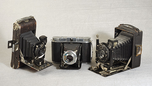 Three folding cameras for paper-backed film rolls