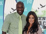 Lamar Odom and wife Khloe Kardashian arrive at the 2010 Teen Choice Awards at Gibson Amphitheatre on August 8, 2010 in Universal City, California.