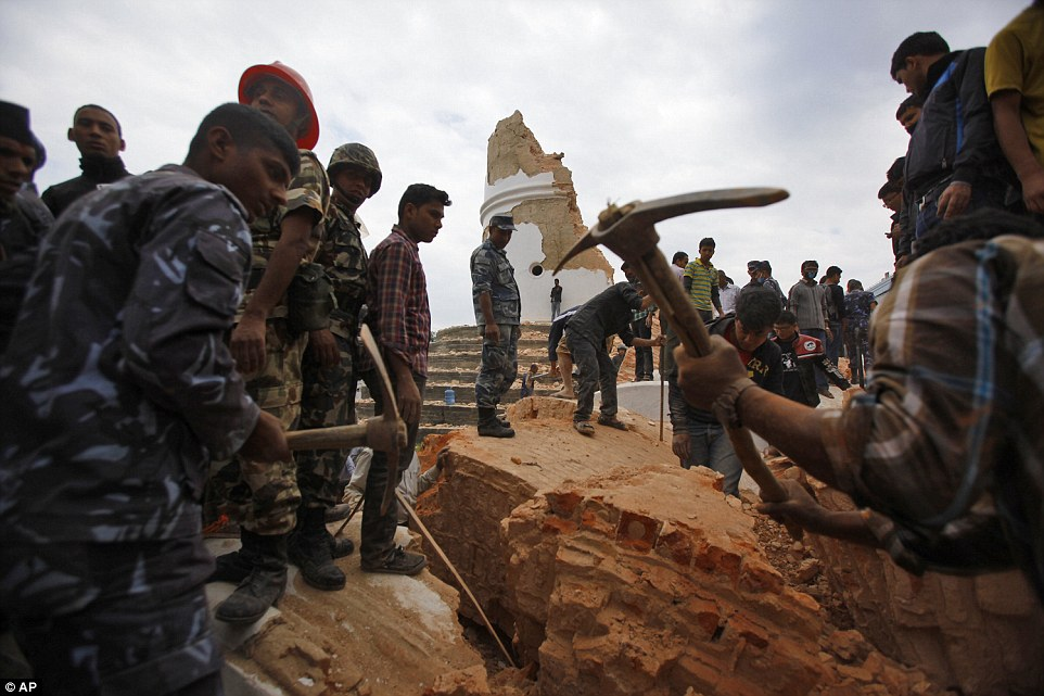 Rescuers remove debris at the  tower, a city landmark, after the quake which had an epicentre was 50 miles north-west of Kathmandu and it had a depth of only seven miles, which is considered shallow in geological terms