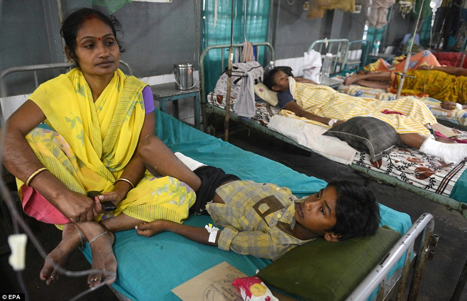 The tremor was felt as far as India which reported 34 deaths. In Silguri, an injured young victim of the quake undergoes treatment in hospital