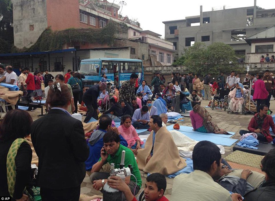Patients wait at the car park of Norvic International Hospital waiting for treatment after an earthquake hit Kathmandu, Nepal