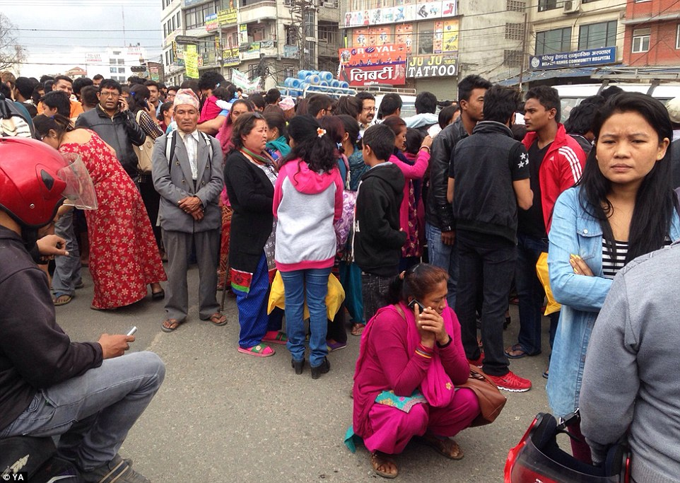 Panicked locals gathered outside in the street after the earthqauke which is thought to have killed two and caused extensive damage with toppled walls and collapsed buildings