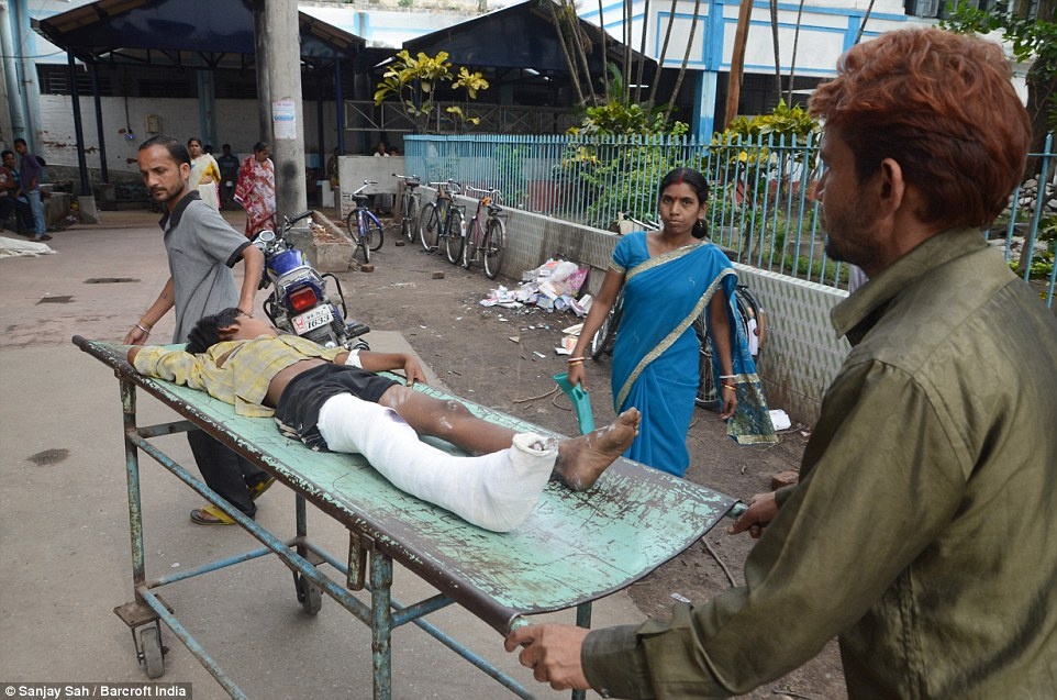The youngster appears to have broken his leg in the disaster which killed at least 34 in India and is thought to have injured many more