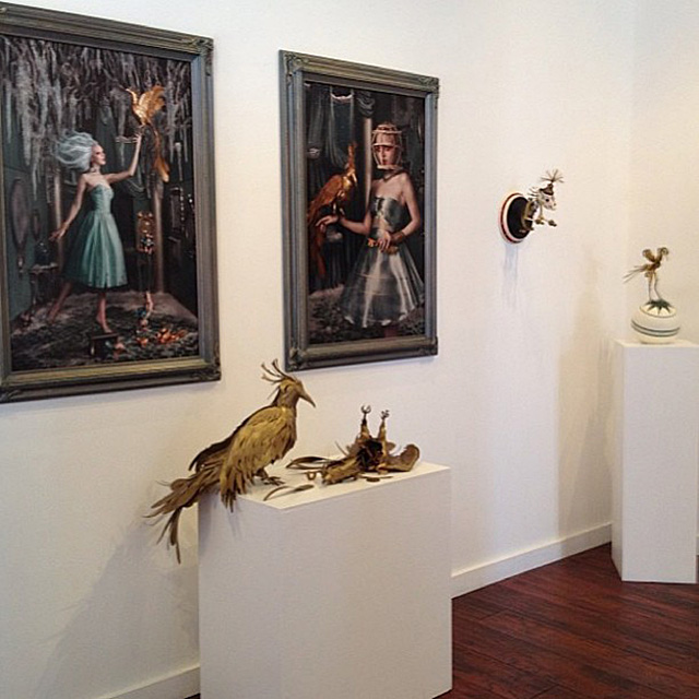 """Final """"Caged"""" pieces and the birds on display at Varnish Fine Art."""