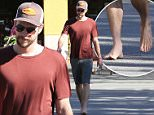 Please contact X17 before any use of these exclusive photos - x17@x17agency.com   Liam Hemsworth with a friend shopping for leafy greens in bare feet at Whole Foods in Malibu\nOctober 26, 2015 X17online.com