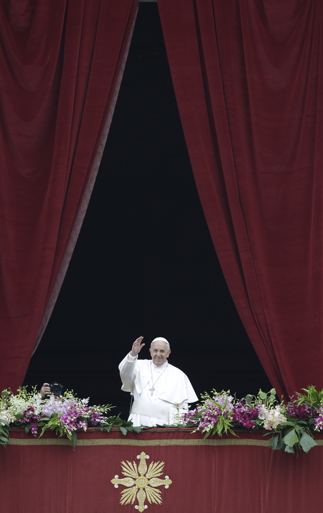 Pope Francis delivers the Urbi et Orbi (to the city and to the world) blessing at the end of the Easter Sunday Mass in St. Peter's Square at the Vatican , Su...