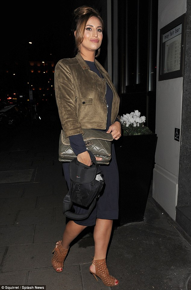Tight fit: Newly-single Fern dressed her lean and slender frame in a dark navy figure-hugging number, a khaki leather jacket and tanned peep toes