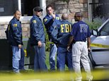 FBI agents talk outside the scene of a raid of the apartment of Najibullah Zazi at the Vistas Apartment Complex at 22959 East Smoky Hill Road in Aurora, Wednesday afternoon, September 16, 2009. Hyoung Chang, The Denver Post