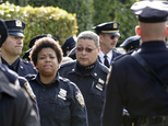 New York police officers arrive for the wake of fellow officer Randolph Holder at the Greater Allen A.M.E. Cathedral, Tuesday, Oct. 27, 2015, in the Queens borough of New York. Holder was shot and killed Tuesday, Oct. 20 while pursuing a suspect in the Harlem neighborhood of New York. The suspect was caught several blocks away with a gunshot wound to his leg. (AP Photo/Mark Lennihan)