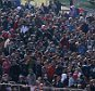 Migrants wait for buses after crossing the border between Slovenian and Austria in Spielfeld, Austria, Monday, Oct. 26, 2015. Tens of  thousands of people are trying to reach central and northern Europe via the Balkans but often have to wait for days in mud and rain at the Serbian, Croatian and Slovenian borders. (AP Photo/Ronald Zak)