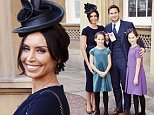 British football player Frank Lampard stands with his partner, television presenter Christine Bleakley, and his daughters Isla and Luna , as he holds his Officer of Order of the British Empire (OBE) medal, after it was presented to him by the Prince William, at an Investiture ceremony at Buckingham Palace in central London, October 27, 2015. REUTERS/John Stillwell/Pool