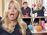 EDITORIAL USE ONLY. NO MERCHANDISING  Mandatory Credit: Photo by Ken McKay/ITV/REX Shutterstock (5308555br)  Ben Shephard and Holly Willoughby Welly Wanging  'This Morning' TV Programme, London, Britain - 27 Oct 2015