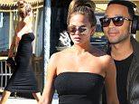 Picture Shows: Chrissy Teigen  October 26, 2015\n \n Pregnant model Chrissy Teigen is spotted out and about in Beverly Hills, California.\n \n Chrissy recently announced that she is expecting her first child with her husband, singer John Legend, and showed off her laid-back maternity style in a strapless black dress and flat black sandals with a gold snake embellishment.\n \n Non Exclusive\n UK RIGHTS ONLY\n \n Pictures by : FameFlynet UK © 2015\n Tel : +44 (0)20 3551 5049\n Email : info@fameflynet.uk.com