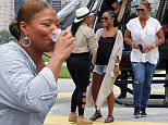 UK CLIENTS MUST CREDIT: AKM-GSI ONLY\nEXCLUSIVE: Rio de Janeiro, Brazil - Queen Latifah enjoys a helicopter ride with friends in Rio de Janeiro.