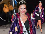 """Demi Lovato was spotted arriving to her NYC hotel after attending a Halloween Party for MTV. She wore an extravagant Purple cape, Crown, and tiny black dress with a sash that read """"Trap Queen"""". Her cape was covered in literal traps, including mouse traps and Bear traps . She looked stunning with purple eye shadow and a big smile.  Pictured: Demi Lovato Ref: SPL1162053  261015   Picture by: 247PAPS.TV / Splash News  Splash News and Pictures Los Angeles: 310-821-2666 New York: 212-619-2666 London: 870-934-2666 photodesk@splashnews.com"""